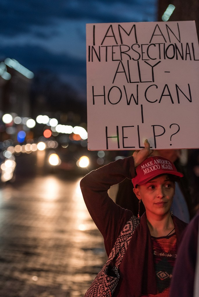 "Megan Yankee holds up her sign stating, ""I am an Intersectional Ally- How can I help,"" while participating in the Athens Women's March gathering outside of the Athens County courthouse on January 20, 2017. (Nickolas Oatley/WOUB)"