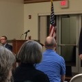 Athens Mayor Steve Patterson, far right, speaks to attendees of a town hall meeting Tuesday night at the Athens Community Center