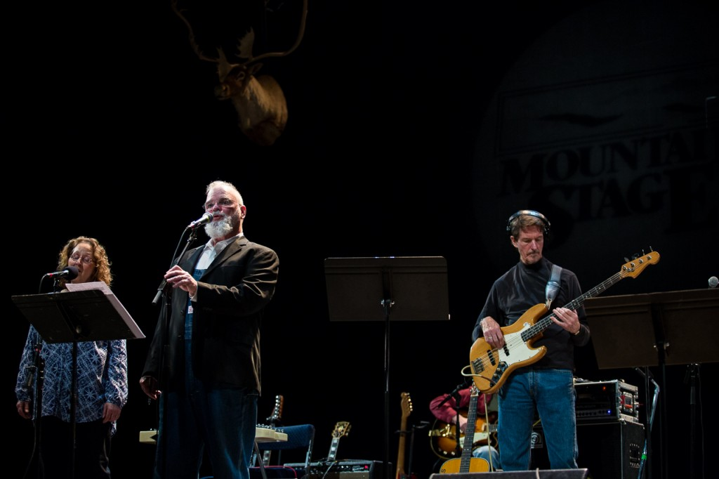 Larry Groce, host of Mountain Stage, welcomes the audience with a song on January 22, 2017 at The Templeton-Blackburn Memorial Auditorium. Produced in West Virginia and distributed by NPR, Mountain Stage is recorded in front of a live audience and features genres ranging from folk and blues to indie and pop. (Erin Clark/WOUB)