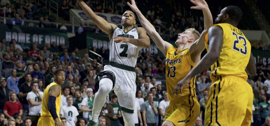 Jaaron Simmons beats a defender for an easy layup during Ohio University's game against Toledo at the Convocation Center in Athens, Ohio on Tuesday, January 25, 2017. (Daniel Linhart/WOUB)
