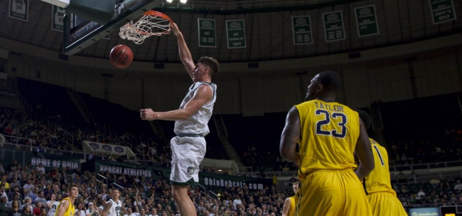 Jason Carter makes the play of the night as he beats two defenders at the baseline and finishes with a slam dunk during Ohio University's game against Toledo at the Convocation Center in Athens, Ohio on Tuesday, January 25, 2017. (Daniel Linhart/WOUB)