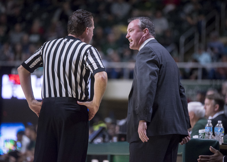 Saul Phillips, Head Coach of Ohio University's Men's Basketball Team, discusses a foul against Ohio University by Eastern Michigan at the Convocation Center on January 14, 2016. (Camille Fine/WOUB)
