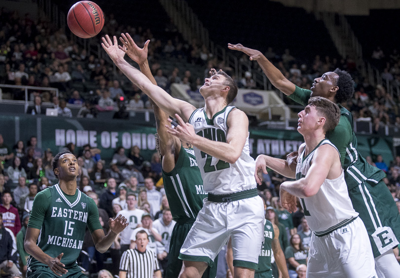 Gavin Block, Ohio University Forward, attempts to tip the ball against Eastern Michigan players at the Convocation Center on January 14, 2016. (Camille Fine/WOUB)