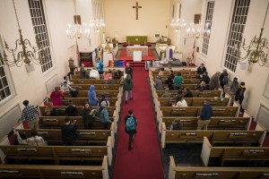 After the meeting people gather to the back of the church to ask more questions on Monday, Jan. 23, 2017. (Michael Swensen/WOUB)