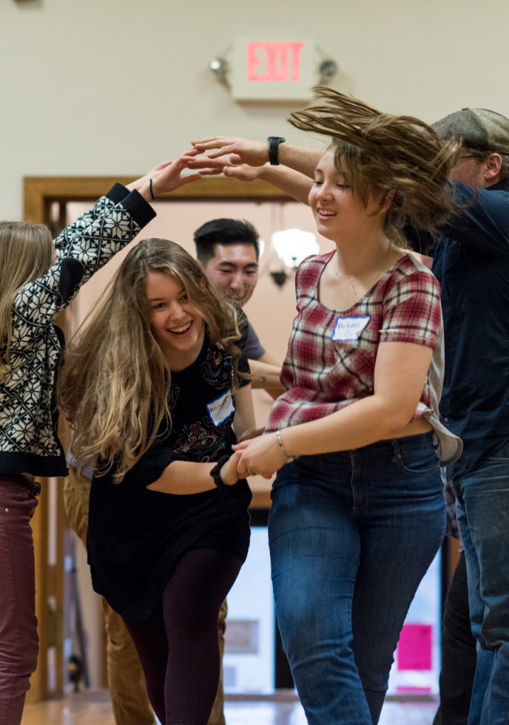 Miciah Clouie (left) and Autumn Watkims dancing at Arts/West during a contra dancing event on January 15, 2016. (Carolyn Rogers/WOUB)