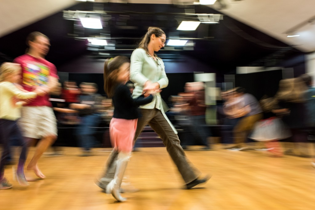 Morgan Quinn dancing with her partner, Autumn Lotus, 5, at the Contra Dance event at Arts/West in Athens, Ohio, on January 15, 2016.(Carolyn Rogers/WOUB)