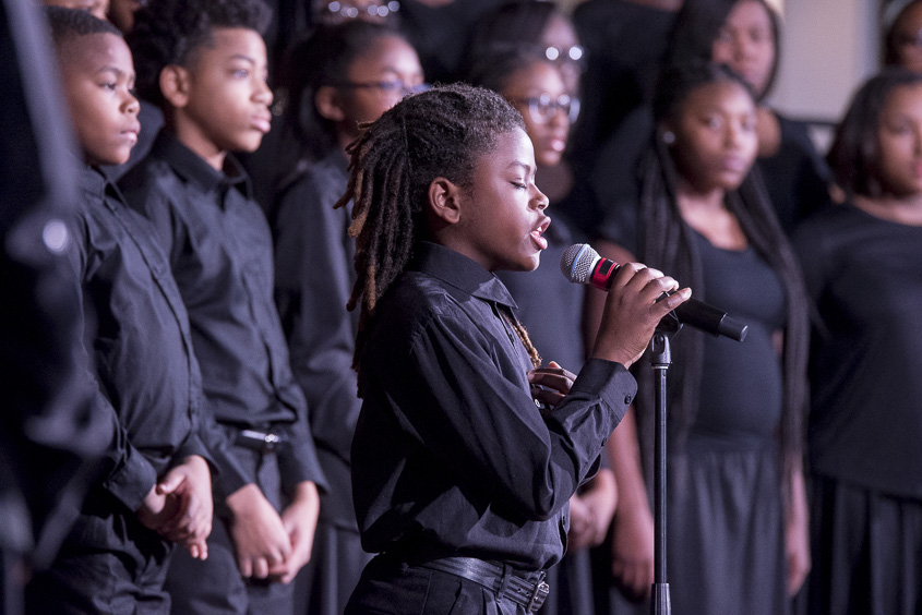 A member of the Baltimore Singing Sensation Youth Choir performs a solo inside of Baker Center Ballroom at the Martin Luther King Jr. Brunch on January 16, 2017. (Camille Fine/WOUB)