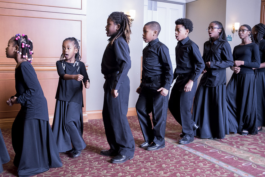 Members of the Baltimore Singing Sensation Youth Choir wait outside of Baker Center Ballroom to perform at the Martin Luther King Jr. Brunch on January 16, 2017. (Camille Fine/WOUB)