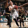 Bobcats' forward Kelly Karlis charges past Western Michigan defenders on Wednesday, January 25, 2017. (WOUB / Drake S. Withers)