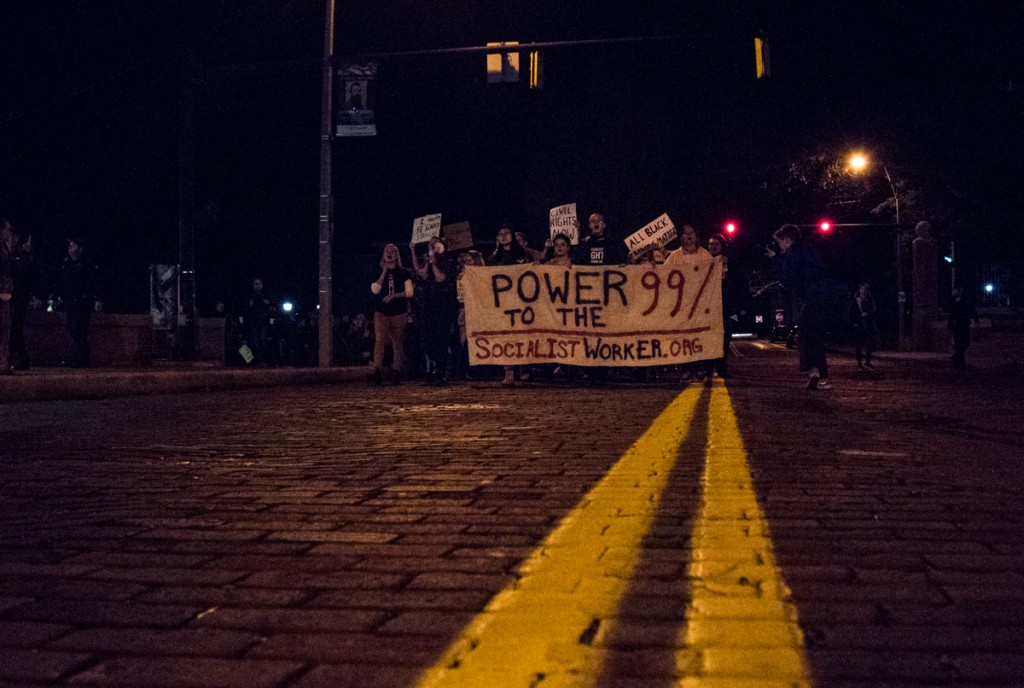 "The Athens WomenÕs March walking through the streets yelling, ""No Trump, no KKK, no fascist USA,""  and other chants in Athens, Ohio, on January 20, 2017. (Carolyn Rogers/WOUB)"