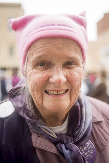 Lois Whealey, a 90-year-old woman from Athens, Ohio, poses for a portrait outside of the Ross County Courthouse to protest on January 21, 2017. (Camille Fine/WOUB)
