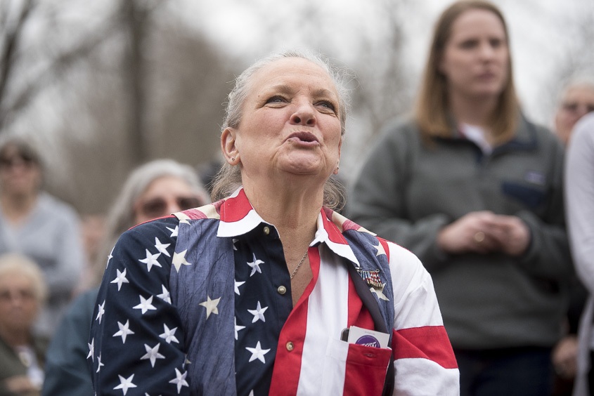 Kathy Green, resident of Highland County, sings along to Imagine by John Lennon being performed at the Ross County Women's March on January 21, 2017. (Camille Fine/WOUB)