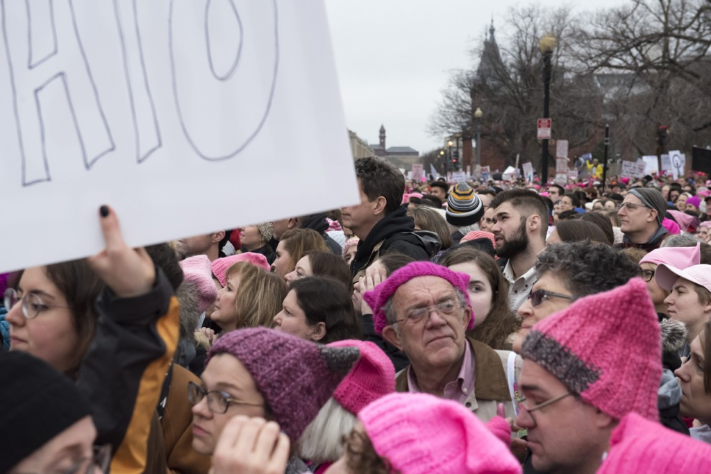 On January 21, 2017, hundreds from the state of Ohio participated at the WomenÕs March on Washington, carrying banners, and wearing pink pussy hats. Participants could be seen holding posters, or wearing sashes, stickers, and buttons, that displayed the state they travelled from. Some in the nearby crowd were from; Louisiana, New York, Maine, Minnesota, Pennsylvania, Illinois, Indiana, Florida, North Carolina, California, and Texas.   (Margo Sabec/WOUB)