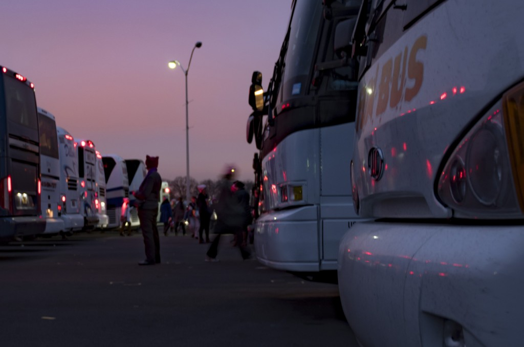 On January 21, 2017, hundreds of thousands participated at the Women's March on Washington. Many of those participants travelled to the march by bus. The parking lots at RFK Stadium are one of the designated parking areas for the more than 1,000 buses that received parking permits for the Women's March on Washington. As night falls, those that travelled by bus gather to board their buses and begin their journey back home. (Margo Sabec/WOUB)