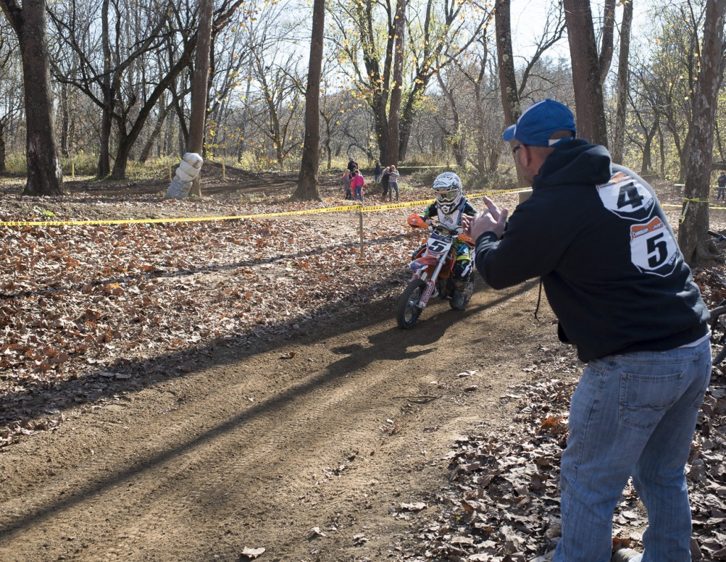 Ryan Cunningham cheers on his son, Joseph, during his race on November 12, 2016 in Nelsonville, Ohio. Ryan tries to make it to all of his son's races and cheers on the sidelines each time they pass.