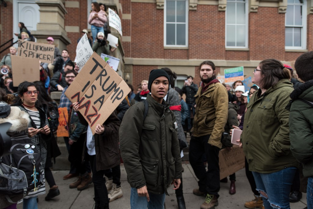 Oliver Stone, a senior at Ohio University, stares at a Trump supporter who was screaming and shouting in the middle of their peaceful protest on Wednesday, February 1, 2017. (Nickolas Oatley/WOUB)