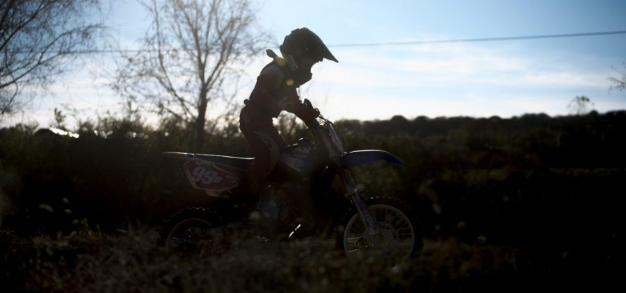 Tanner Collins rides his dirt bike at the Cunningham's race track in Nelsonville, Ohio on November 5, 2016. The Cunningham's often invite their friends and family over to practice and socialize.
