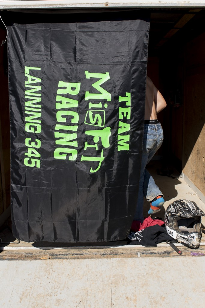 Cunningham goes behind the banner hung on Lanning's trailer to change into his racing clothes on November 6, 2016.