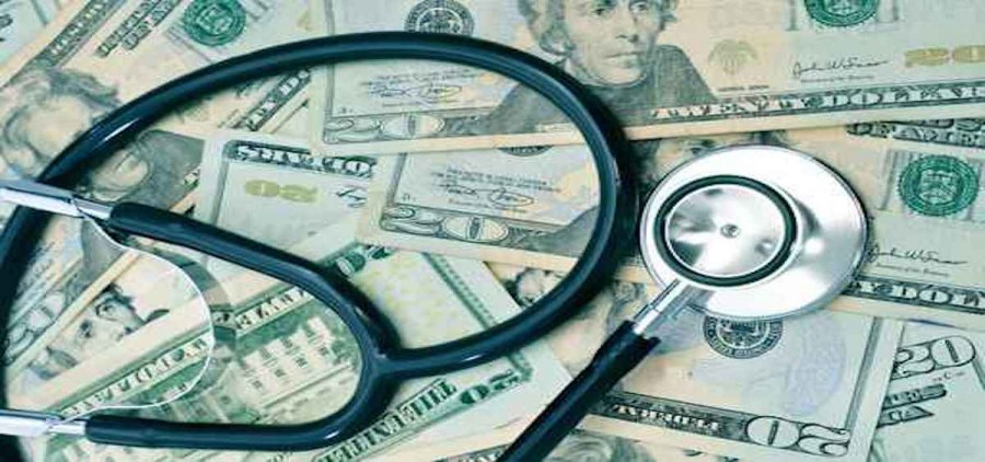 A stethoscope on top of money