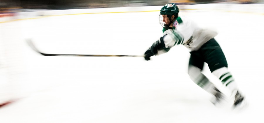 Ohio University player skating for the puck whiling playing against University of Pittsburgh in Bird Arena at Ohio University in Athens, Ohio,  on February 3, 2017. The bobcats won 9-0.