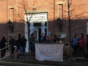 A group of fellow protesters stand outside the Athens County Municipal Court, where those charged after a Baker Center sit-in appeared in court on Monday.  Susan Tebben / WOUB News
