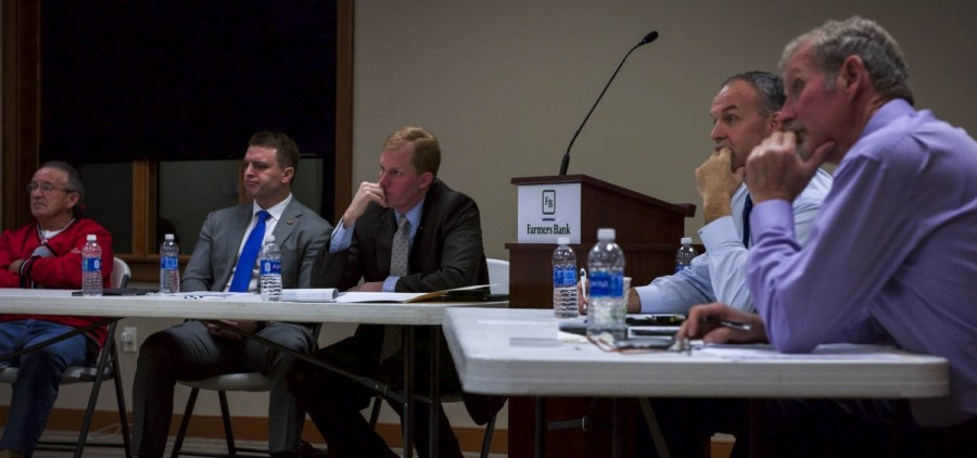 Bill Spaun, Ohio Representative Jay Edwards, Brad Cole abd Meigs County commissioners Mike Bartrum and Tim Ihle listen during a February meeting about the Managed Care sales tax in Pomeroy, Ohio. (Daniel Linhart/WOUB)