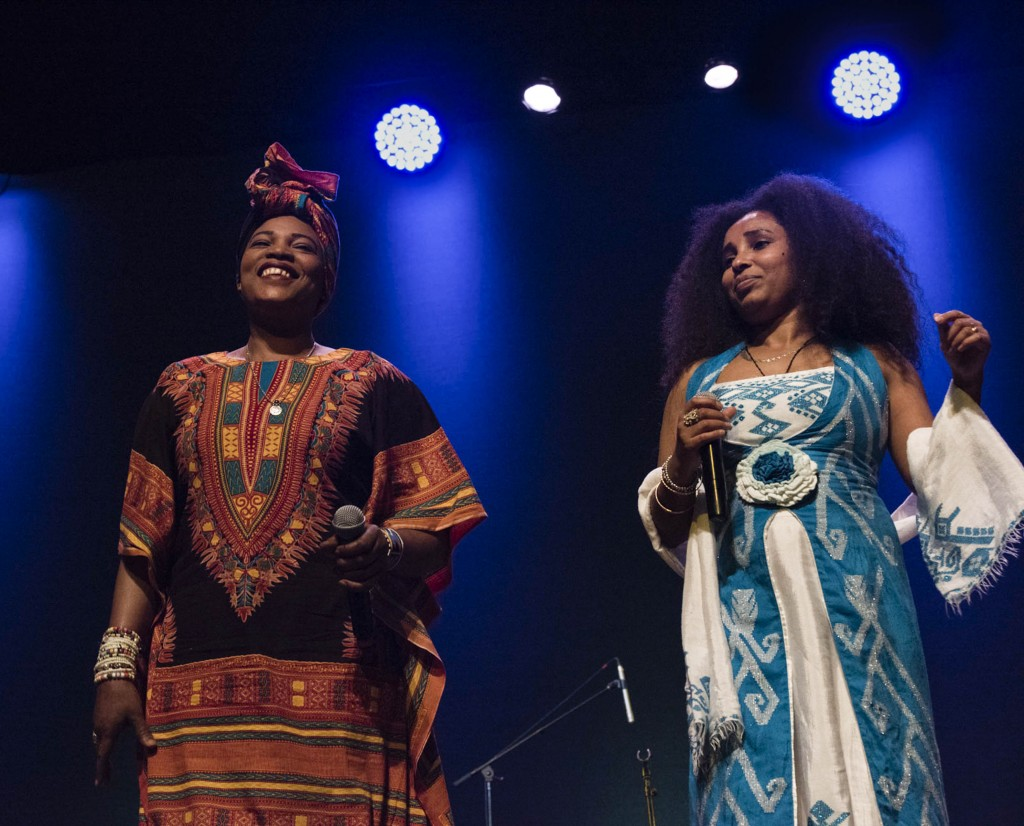 Asia Madani (Right) and Selamnesh Zemene (left) laugh and sing together as they perform a duet on Feb. 27, 2017. (Meagan Hall/ WOUB)
