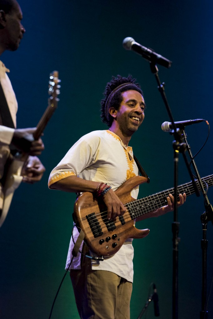 Ahmed Omar, a bass player from Egypt, smiles during the Nile Project performance on Feb. 27. (Meagan Hall/ WOUB)