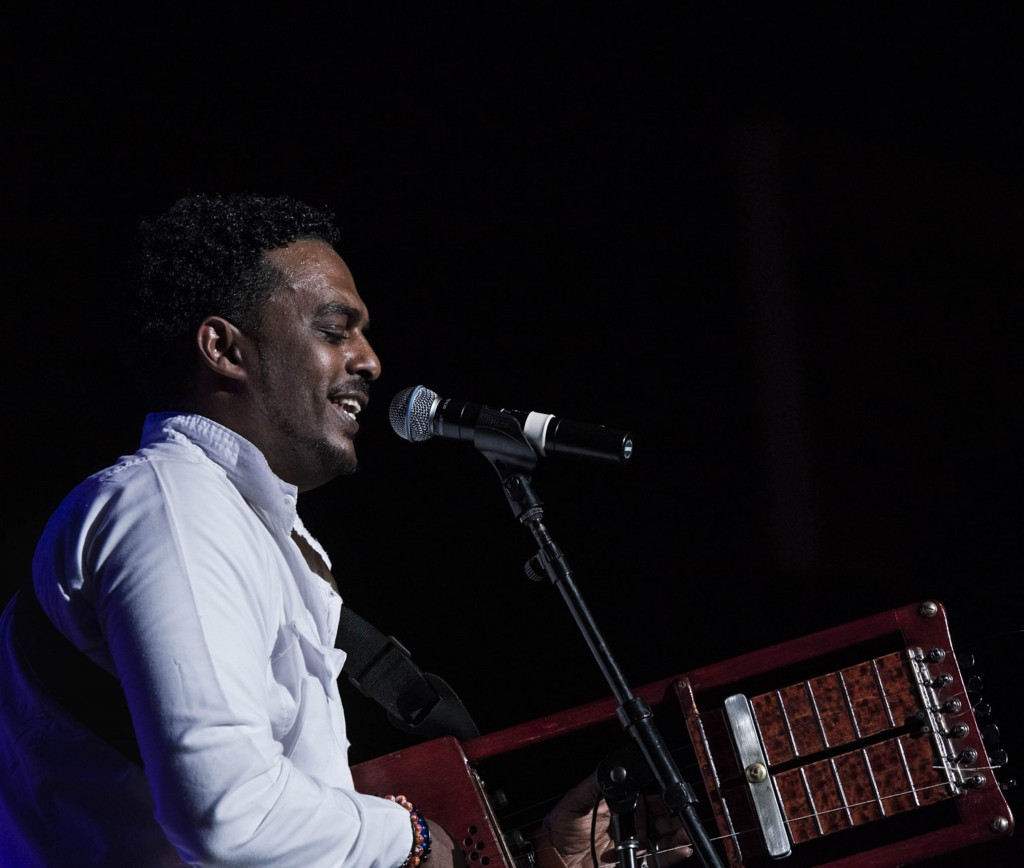 Asrat Ayalew, of Ethiopia, sings and plays a Nile instrument during the Nile Project performance. (Meagan Hall / WOUB)