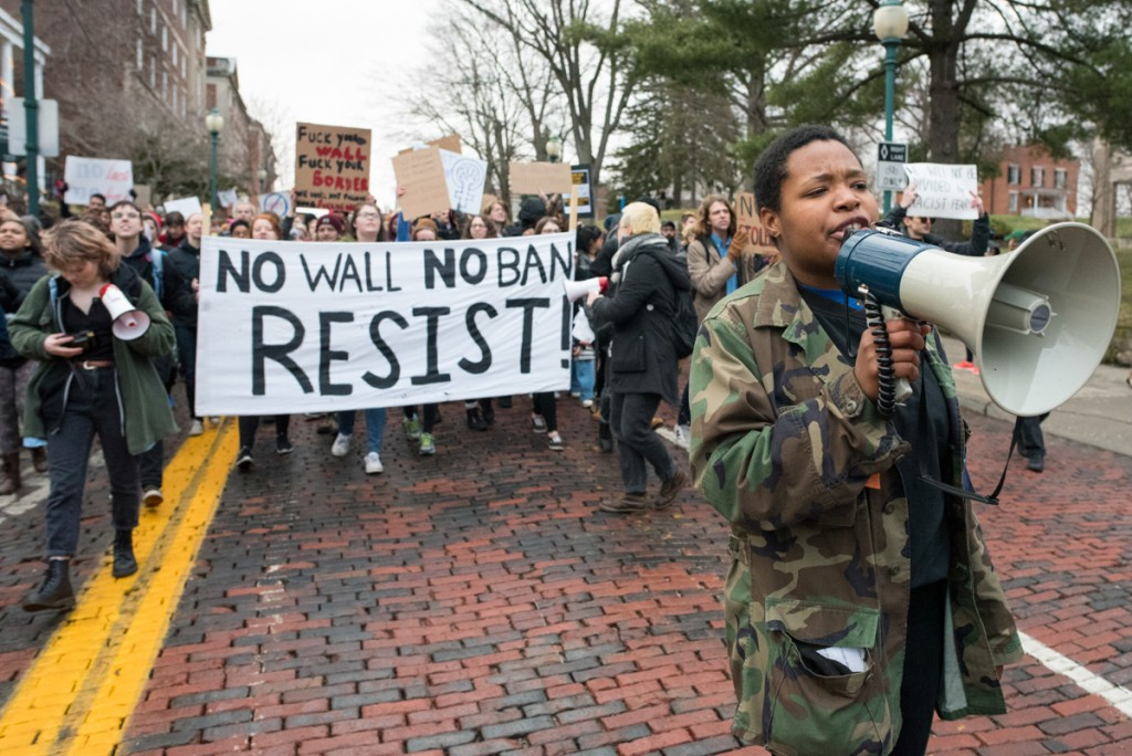 Anissa Matthews leads a march in solidarity of the recent immigration issues down Court Street in Athens, Ohio on February 2, 2017. (Robert Green/WOUB)