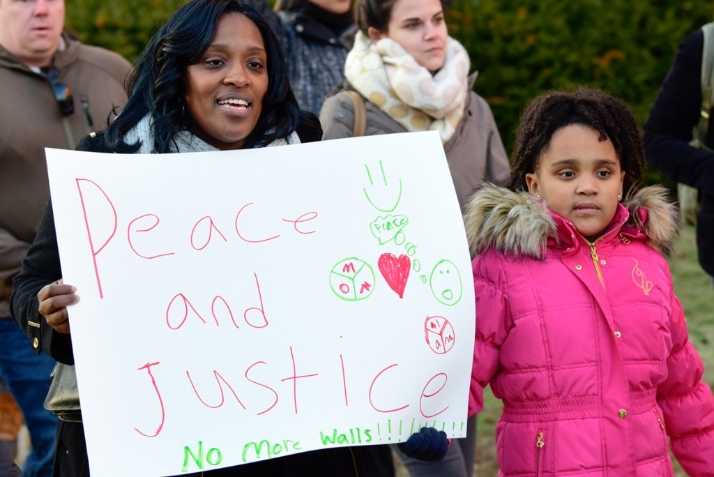 Brandi Baker and her daughter, Alana Cumba, march for peace and justice in the Healthcare Allies Asylum March in Athens, Ohio on February 3, 2017 (Robert Green/WOUB)