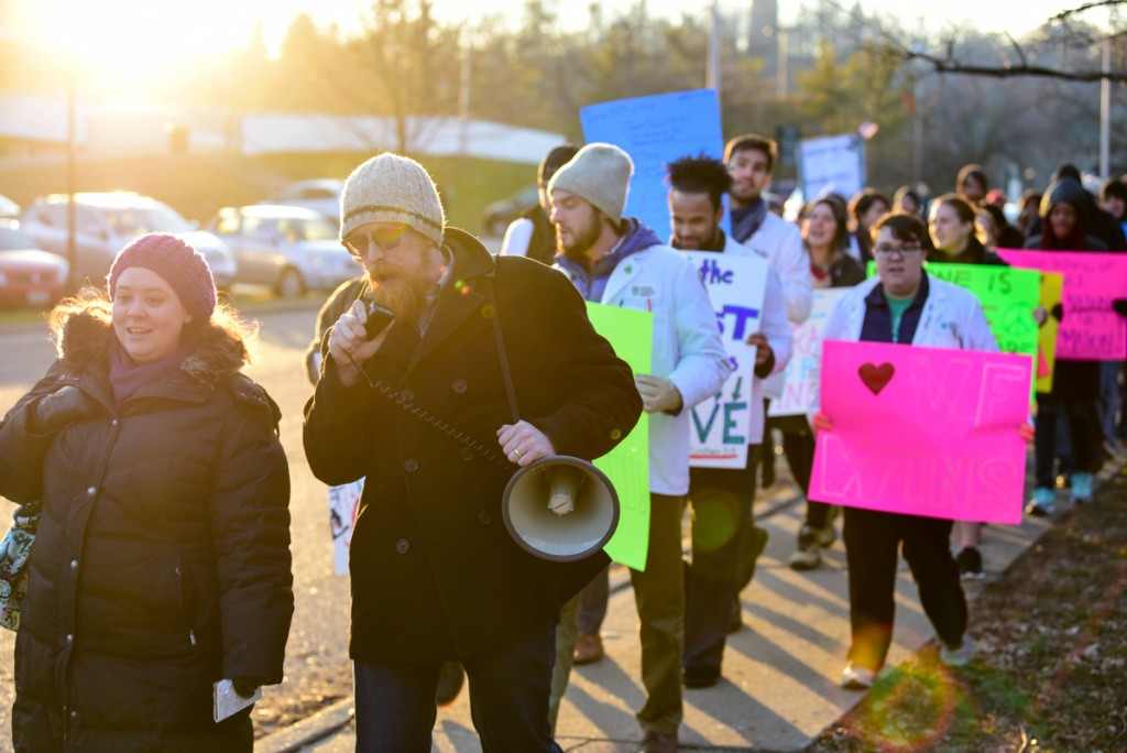Protestors march at sunset in the Healthcare Allies Asylum March in Athens, Ohio on February 3, 2017 (Robert Green/WOUB)