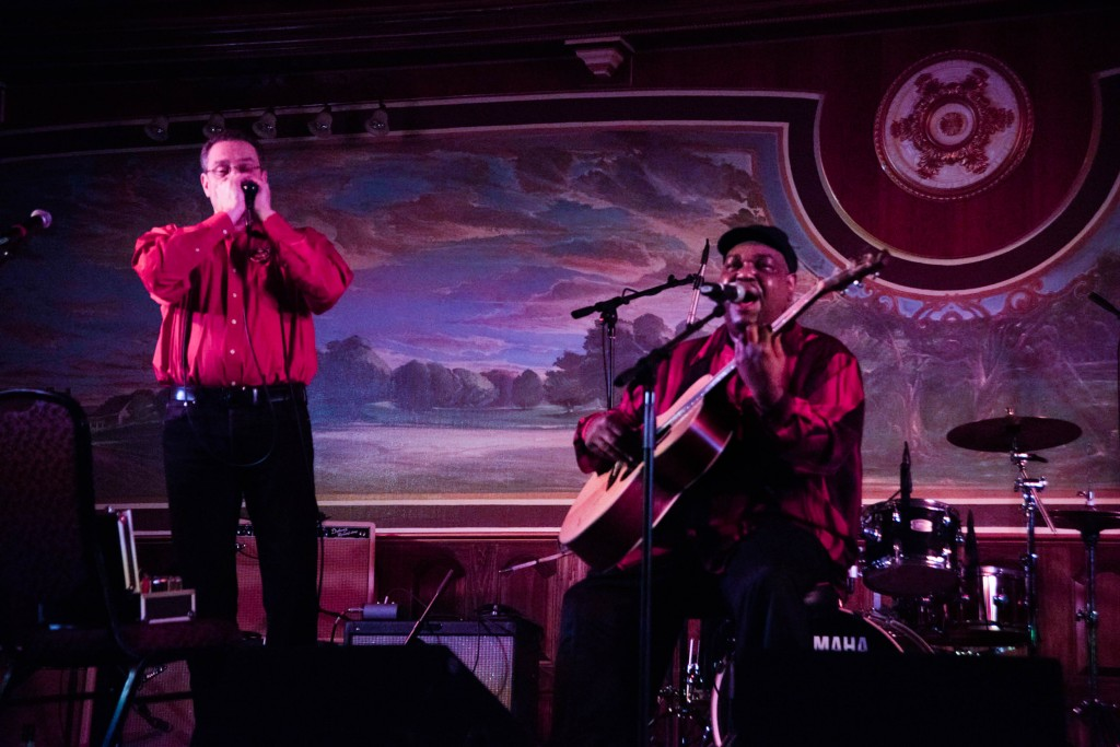 """Luther (right) and Cedric (left) """"Lightning Blues"""" performs at the 25th Annual River City Blues Competition held at the Lafayette Hotel in Marietta, OH on Feb. 18, 2017. (WOUB/Drake Withers)"""