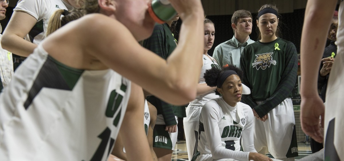 During a timeout, Quiera Lampkins is surrounded by teammates as they listen to strategies from the coaching staff. The Bobcats lost the game to Central Michigan 64-70 Wednesday night, February 15, 2017 at the Convocation Center. (Margo Sabec/WOUB)