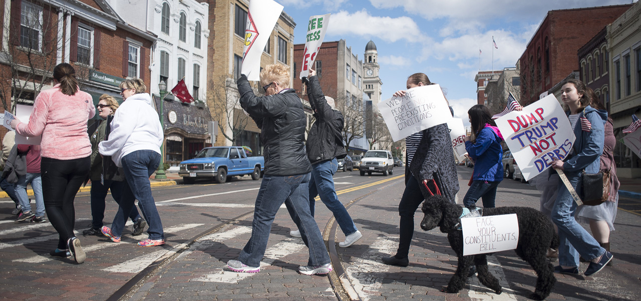 People march through the streets of downtown Marietta, Ohio on February 25, 2017. (Camille Fine/WOUB)