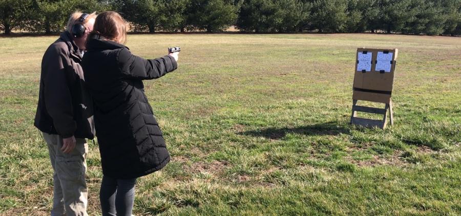 Hilltop Range Safety Officer John Euler teaches student to shoot.