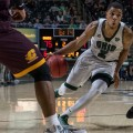 Ohio University point guard Jaaron Simmons (2) drives by Marcus Keene (3) and Cecil Williams (21). (Nickolas Oatley/WOUB)