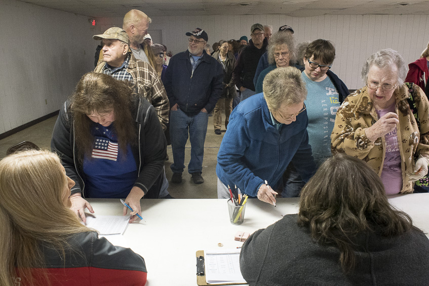Senior community members sign up for the Commodity Supplemental Food Program in Wellston, Ohio on February 1, 2017. The Ohio Food Bank provides stable food to approximately four thousand senior citizens once a month. (Camille Fine/WOUB)