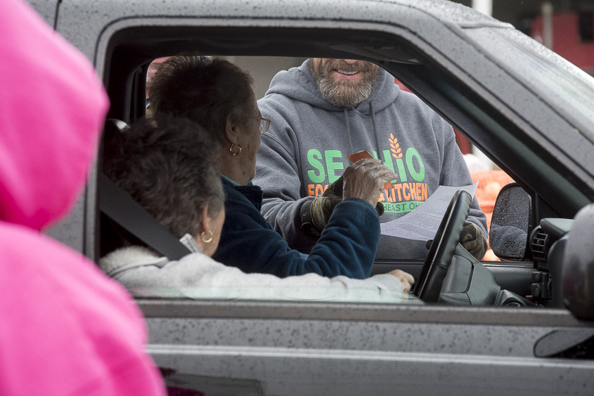 Monte Hixenbaugh, a delivery driver for the South Eastern Ohio Food Bank, provides seniors with food in Wellston, Ohio on February 1, 2017. (Camille Fine/WOUB)