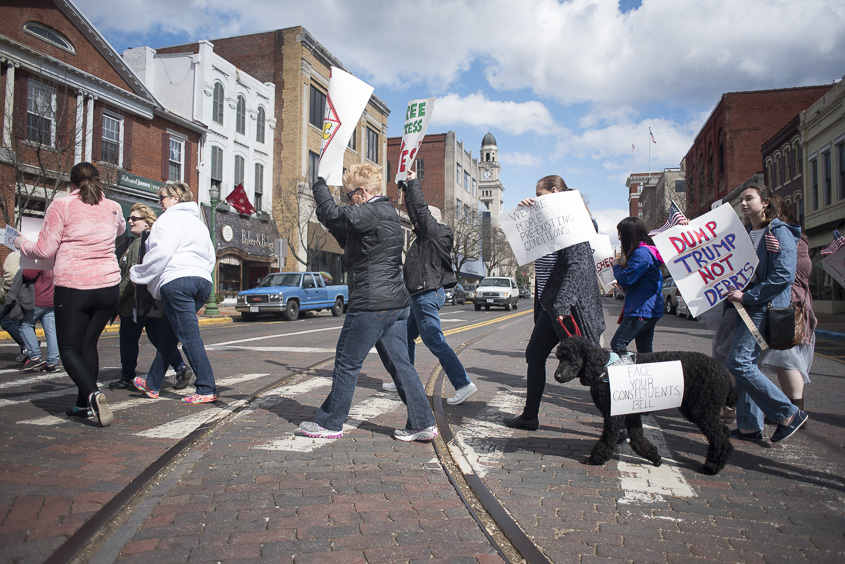Protesters march through the streets of downtown Marietta, Ohio on Febuary 25, 2017. (Camille Fine/WOUB)
