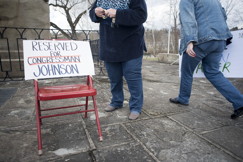 Protesters make a seat for Congressman Bill Johnson, who they claim have not responded to their concerns, in Marietta, Ohio on Febuary 25, 2017. (Camille Fine/WOUB)