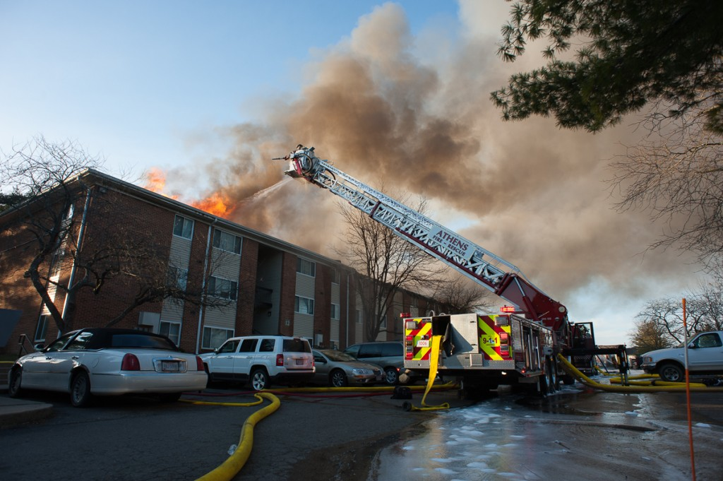 Firefighters attempt to stop the fire in Carriage Hill building number 12 on February 26th, 2017. (WOUB / Drake Withers)