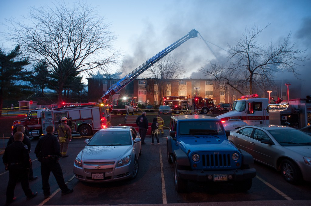 Emergency responders continue to fight the fire in Carriage Hill building number 12 as more vehicles arrive from neighboring cities. (Drake Withers / WOUB)