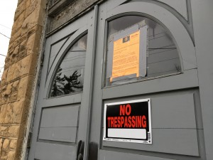 Signs on the door of the church, which were placed there by the investigator.