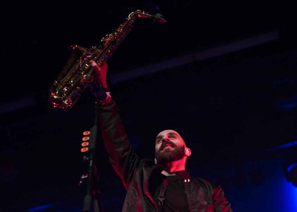 Sam Harris, lead vocalist of X Ambassadors, lifts his saxophone towards the crowd during one of X Ambassadors opening songs on March 21, 2017 at Ohio University. (Meagan Hall/WOUB)