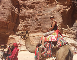 Former OU student Alena Klimas rode a camel on her study abroad trip to Jordan in 2015. OU has current exchanges and partnerships with five Middle Eastern countries.