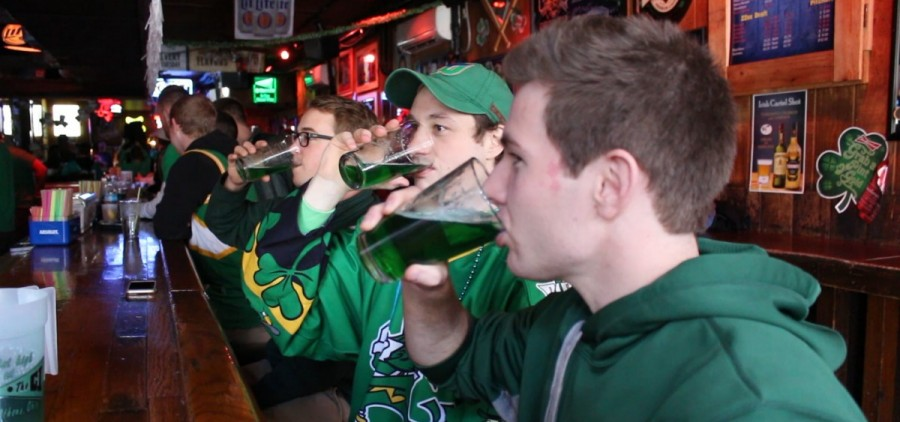 Celebrants drinking green dyed beer in The CI.
