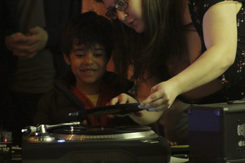 A young participant in Marie Chavez's abstract turntable workshop enjoys creating sound art alongside another participant in the workshop. (Marie Swartz/WOUB)