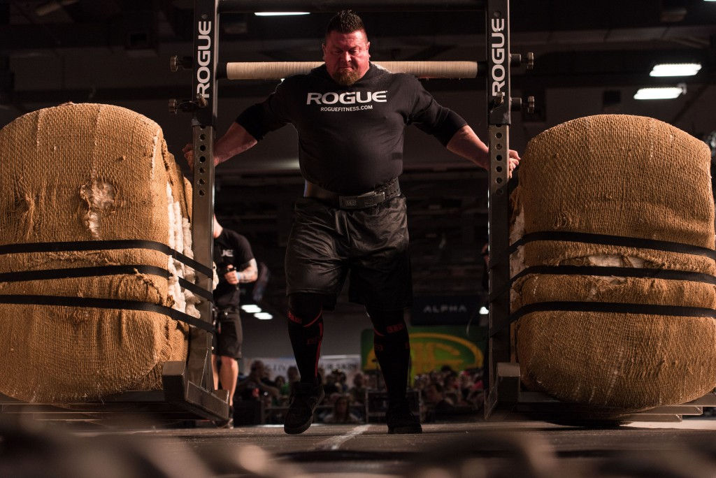 Jerry Pritchett of Phoenix, Arizona, waltzes across the stage carrying 1700 pounds of weight on his back in the Arnold Classic. (Nickolas Oatley/WOUB)
