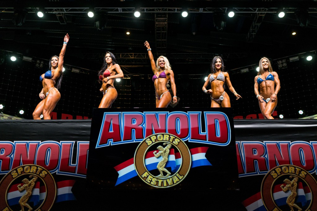 Contestants during the Bikini International pose on stage for the judges at the Greater Columbus Convention Center on Thursday, March 2. (Nickolas Oatley/WOUB)